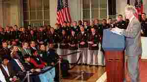 President Bill Clinton speaks about his crime bill to police officers at the Justice Department in April 1994. This week, Clinton defended the measure, which has been criticized by Black Lives Matter protesters.