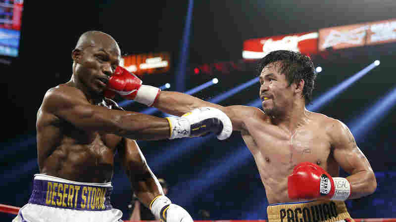 Manny Pacquiao (right), of the Philippines, hits Timothy Bradley Jr. during their WBO welterweight title boxing bout on Saturday in Las Vegas.