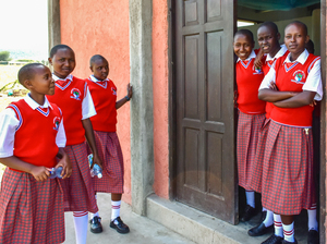 Students from the Sekenani Girls' School gather outside their dormitory after lunch.