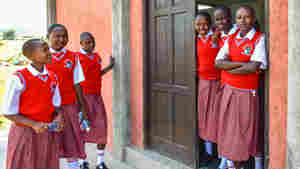 Students from the Sekenani Girls Secondary School gather outside their dormitory after lunch. The new school is the first high school for girls in the Maasai region.