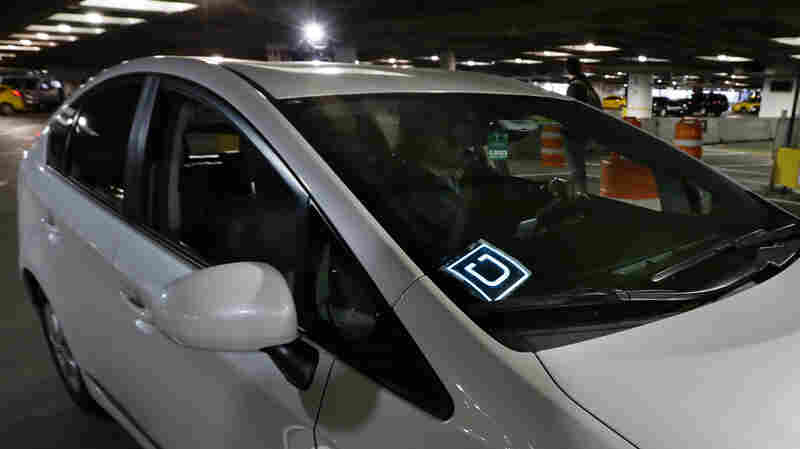A driver for Uber arrives at an authorized customer pickup area at Seattle-Tacoma International Airport.