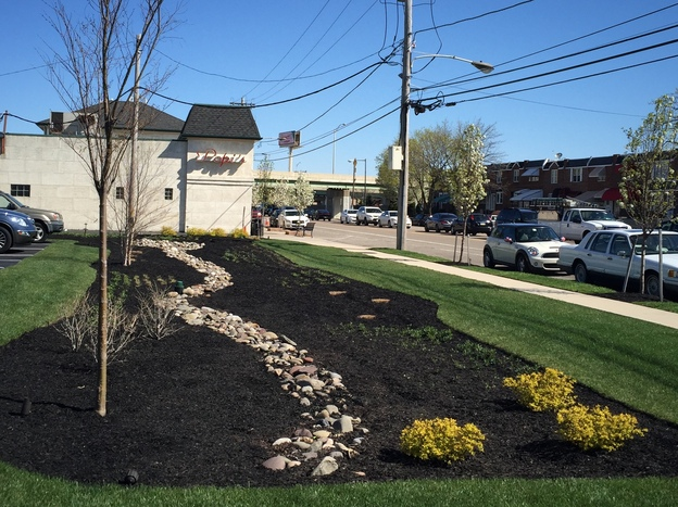 Poppi's Restaurant parking lot with the new rain garden that helps reduce runoff.