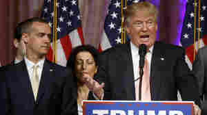 Donald Trump's campaign manager Corey Lewandowski stands next to the candidate last month in Palm Beach, Fla. Lewandowski will not be prosecuted for battery of a reporter, according to a source close to the investigation.
