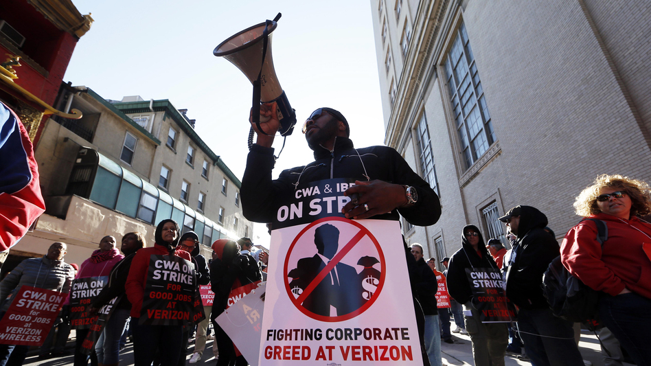 Verizon workers picket outside one of the company's facilities in Philadelphia Wednesday. Verizon landline and cable workers on the East Coast walked off the job Wednesday morning after little progress in negotiations since their contract expired nearly eight months ago. (Matt Rourke/AP)