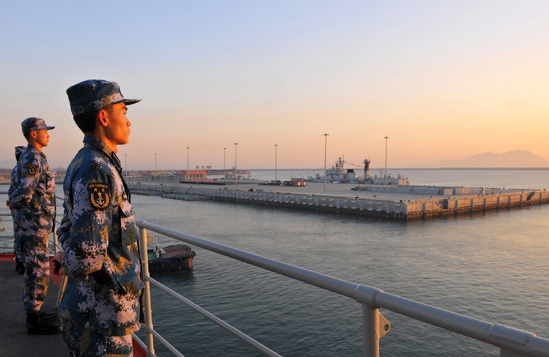Members of the Chinese navy stand guard on China's first aircraft carrier, Liaoning, in 2013. Tensions in the South China Sea have grown over territorial disputes between China, the Philippines, Japan, Vietnam and others.