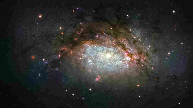 NGC 3597, seen in this Hubble Space Telescope image, is the product of a collision between two good-sized galaxies, and is slowly evolving to become a giant elliptical galaxy.