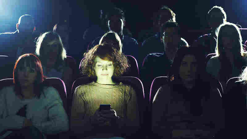 Clash Of The Screens: Should Movie Theaters Allow Texting? AMC Says Maybe