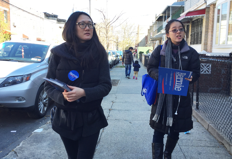 Shiman Shan (left) and Brenda Nguyen canvassed voters for the Bernie Sanders campaign in a New York City neighborhood with a growing Chinese-American community. (Hansi Lo Wang/NPR)