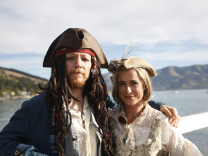 Bridegroom Toby Ricketts and bride Marianna Fenn stand on a jetty in Akaroa Harbour, New Zealand, on Saturday.