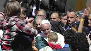 Pope Francis meets migrants at the Moria refugee camp on the Greek island of Lesbos on Saturday.