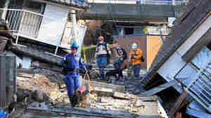 PHOTOS: Rescuers Search For Survivors After Powerful Quakes Hit Southern Japan