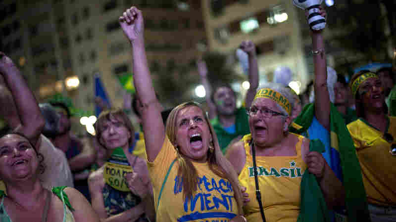 Anti-government demonstrators on Copacabana Beach in Rio de Janeiro, Brazil, watch televised proceedings of the lower house of Congress as lawmakers vote whether to impeach President Dilma Rousseff.