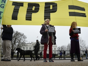 Activists hold a rally to protest the Trans-Pacific Partnership (TPP) in front of the White House in February 2016 in Washington, D.C.