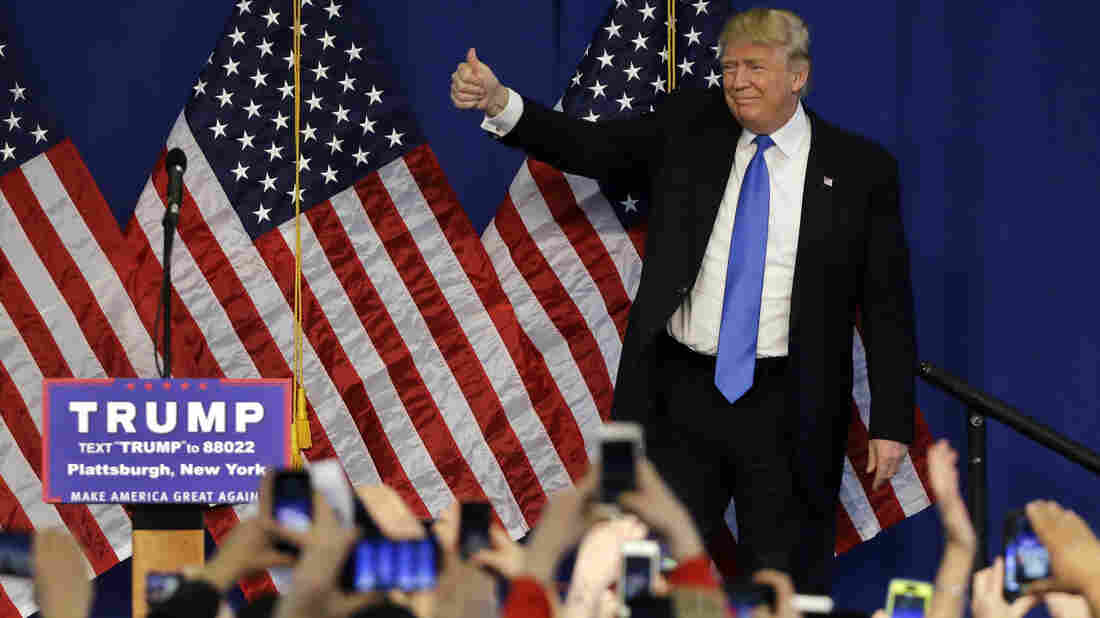 Republican presidential candidate Donald Trump gives thumbs up to the crowd as he arrives to a campaign rally last week in Plattsburgh, N.Y.