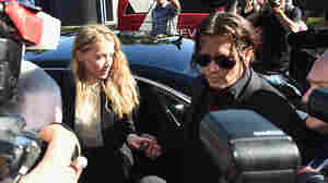 Johnny Depp and Amber Heard arrive at Southport Magistrates Court on Monday on Australia's Gold Coast. Heard faced two counts of breaching Australia's quarantine laws by bringing in the couple's pet dogs, Pistol and Boo, on a private jet in May 2015.