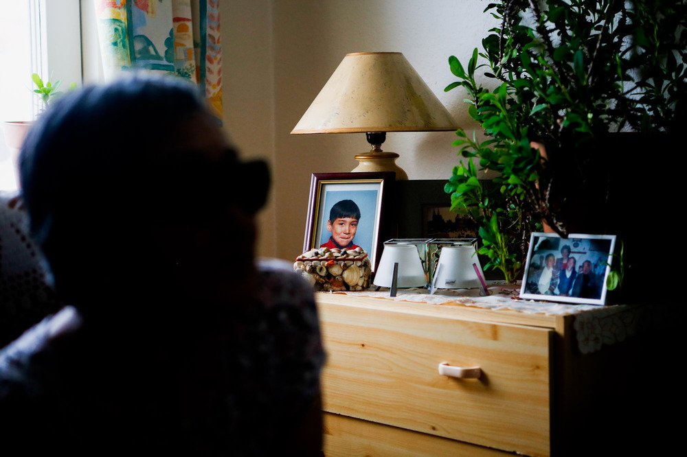 A portrait of one of Atsa Schmidt's grandsons sits on a dresser in her Nuuk living room.