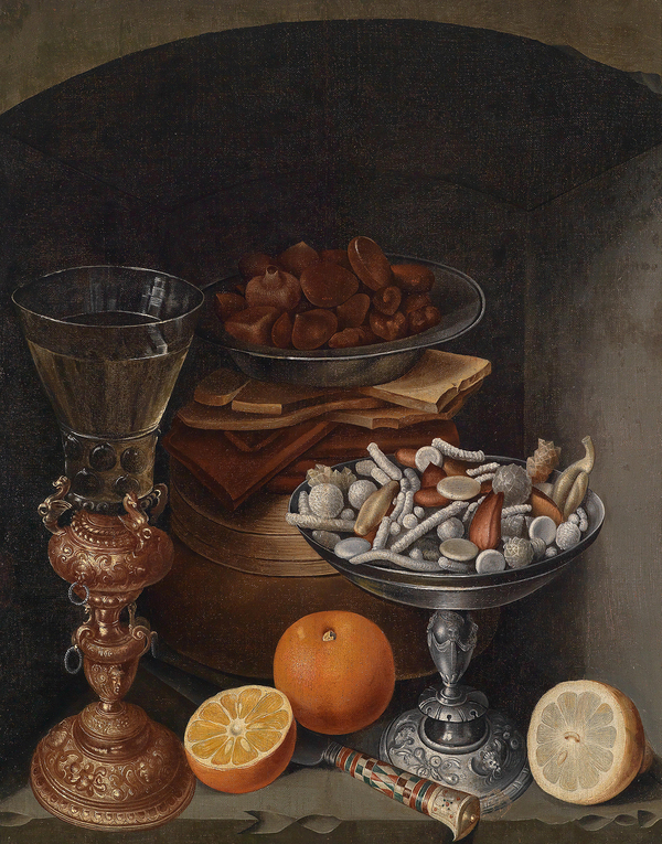 "Still life with a bowl of candies and comfits, likely done in the 17th century. The landed gentry and even well-fed merchants could show off their wealth with a banquet of conserves and comfits – a candy made of a nut or seed coated in sugar. In The Merry Wives Of Windsor, Falstaff calls for ""kissing comfits"" to fall from the sky."