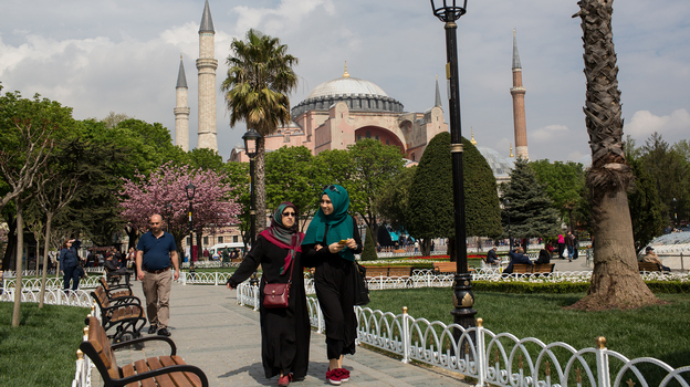 People walk in front of Istanbul's Hagia Sophia on April 12. Turkey has seen tourist numbers plummet following a series of deadly terrorist attacks and a travel ban by Russia. (Getty Images)