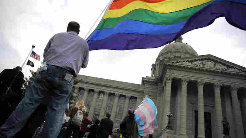 "Mathew ""Skippy"" Mauldin holds a flag during a rally outside the Missouri State Capitol, on March 31, in Jefferson City. He was protesting a proposed state constitutional amendment to protect some businesses citing religious objections while denying goods or services related to same-sex weddings."