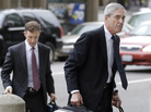 Former FBI Director Robert Mueller, right, arrives for a court hearing in San Francisco Thursday. Mueller has been overseeing talks about a settlement between Volkswagen, the U.S. government, and the car company's customers.