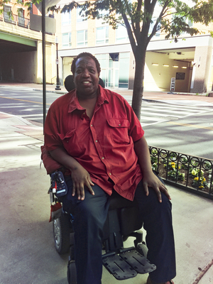 """Thomas Mangrum of Washington, D.C., has been wheelchair-bound for 15 years. The company that provides his helper --€"""" who assists him with his day-to-day activities — will have some tough choices to make once new regulations regarding overtime pay for lower-salaried workers come into effect."""