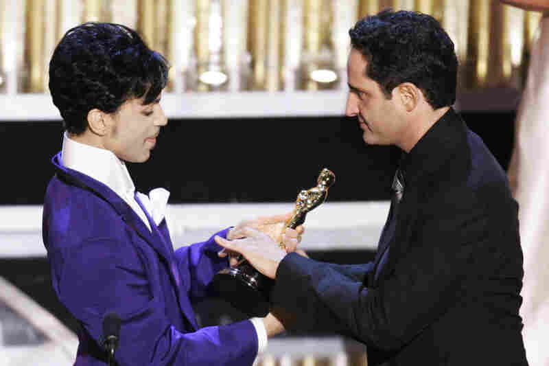 "Uruguayan singer Jorge Drexler receives the Oscar from Prince after ""Al Otro Lado del Rio"" from The Motorcycle Diaries won best original song at the 77th Academy Awards in 2005."