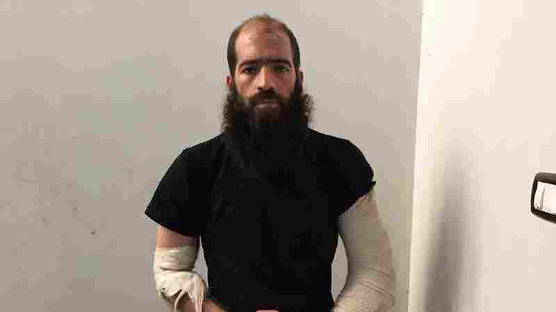 "Ahmed Darwish appears in a police station in Rumeilan, northern Syria, after being captured by Kurdish fighters as he was running away from a battle. He was wounded in a coalition airstrike in support of anti-ISIS forces. ""There was camaraderie, friendship, like a brotherhood between us,"" he says of his time in ISIS."