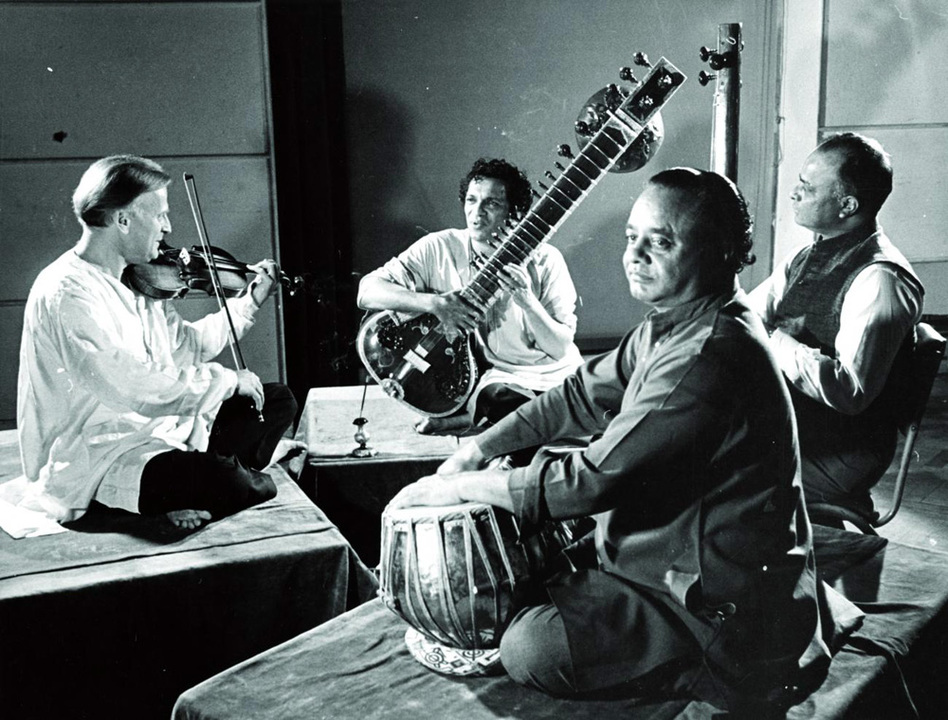 In 1952, Menuhin travelled to India where he met Ravi Shankar (second from left). The two men recorded three albums together and became lifelong friends.    (Warner Classics)