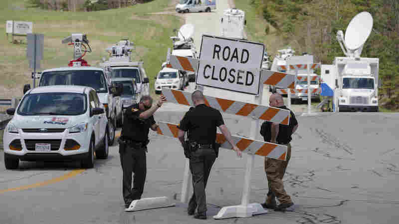 Authorities set up road blocks at an intersection at the perimeter of a crime scene, on Friday in Pike County, Ohio.