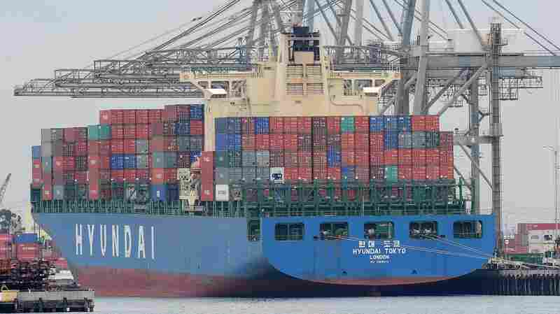 A container ship is unloaded at the Port of Los Angeles. Voters in this year's presidential election have deep feelings about trade — and often are at odds with each other about it.