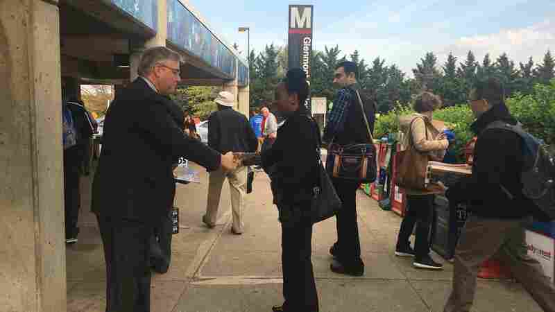 Maryland congressional candidate David Trone shakes hands outside the Glenmont Metro station in Silver Spring, Md., on Thursday morning.
