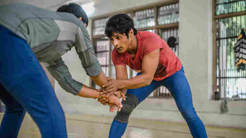 "Neetu trains nearly 8 hours a day at a wrestling facility in Rohtak, India. Her coach says, ""She doesn't take a break for even one minute."""