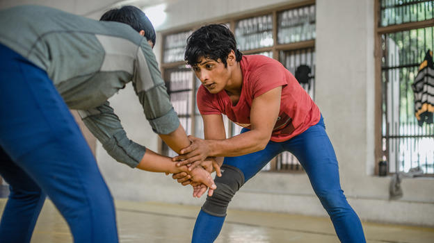 "Neetu trains nearly 8 hours a day at a wrestling facility in Rohtak, India. Her coach says, ""She doesn't take a break for even one minute."" (for NPR)"