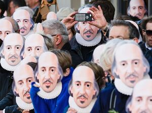 People wearing masks depicting William Shakespeare line the street during a parade to mark 400 years since the bard's death in Stratford-upon-Avon in central England on Saturday.