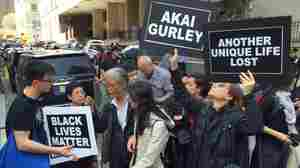 Supporters of Akai Gurley's family gather outside the courthouse where former New York City police officer Peter Liang was sentenced for Gurley's shooting death in Brooklyn, N.Y.