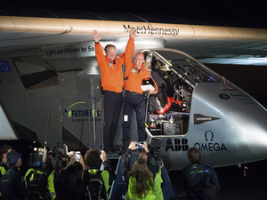 Solar Impulse 2 pilots Bertrand Piccard (right) and Andre Borschberg celebrate after Piccard landed their solar-powered plane at Moffett Field in Mountain View, Calif., on Saturday.