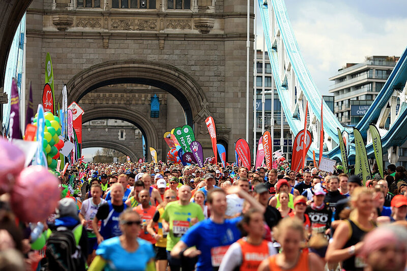Runners make their way across Tower Bridge during the Virgin Money London Marathon on Saturday in London.