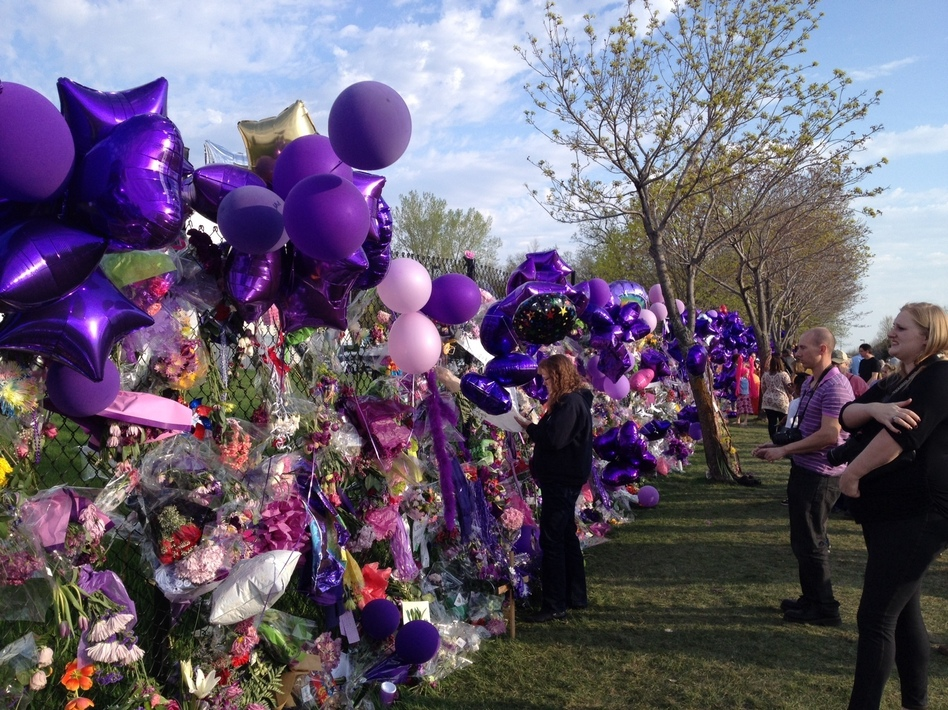 Scores of fans visited Prince's Paisley Park compound in Chanhassen, Minn., on Saturday afternoon. The fence has rapidly become a makeshift memorial celebrating the life of the artist. (Nancy Rosenbaum for NPR)