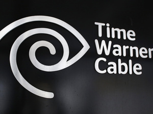 The Time Warner Cable corporate logo is displayed at a company store in New York.