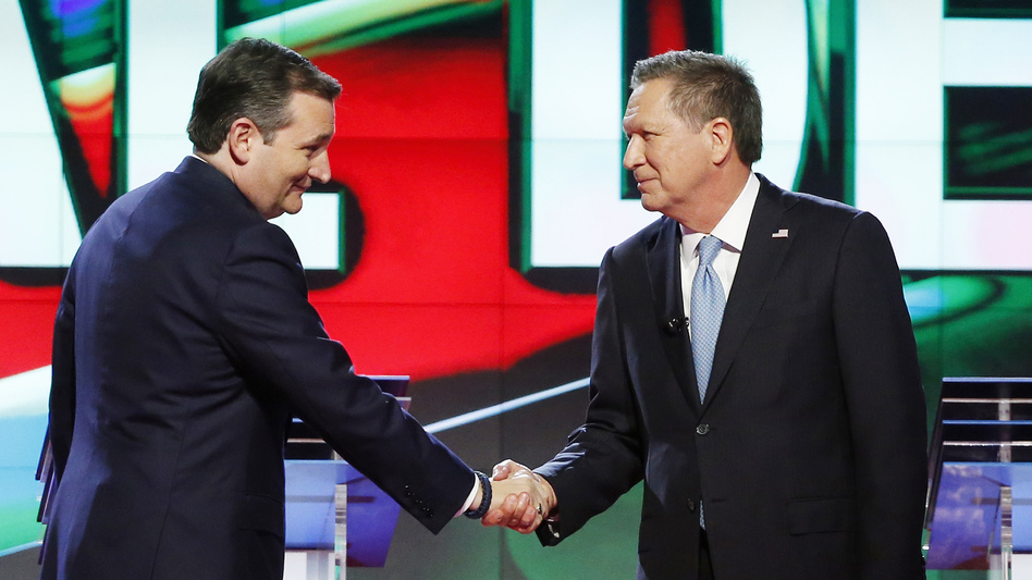 Republican presidential candidates Ted Cruz and John Kasich shake hands at the start of a CNN debate in Coral Gables, Fla., in March. (Wilfredo Lee/AP)