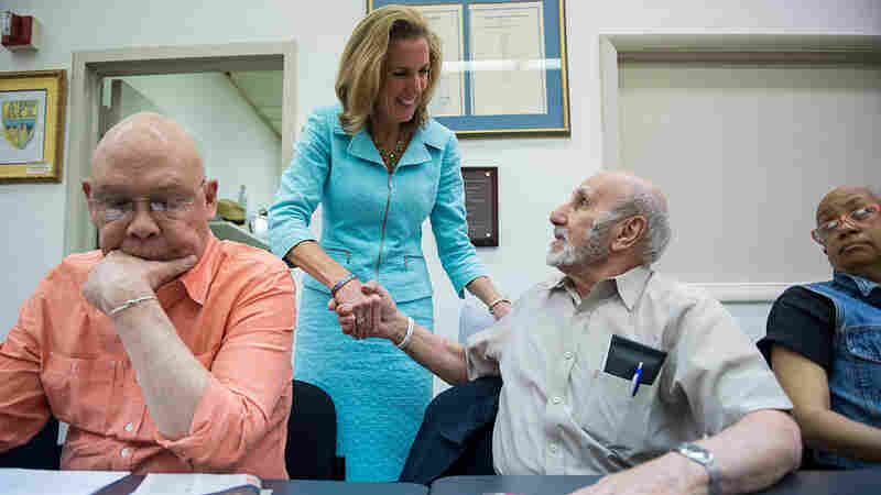 Candidate for U.S. Senate Katie McGinty, D-Pa., shakes hands with attendees as she arrives for her roundtable discussion with seniors at the Philadelphia Federation of Teachers in Philadelphia last week.