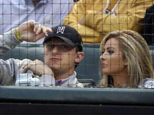 Johnny Manziel and his then-girlfriend Colleen Crowley at a baseball game in Arlington, Texas, on April 14, 2015.