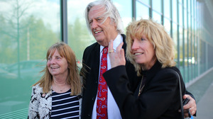 (From left) Margaret Aspinall of the Hillsborough Family Support Group, attorney Michael Mansfield and Yvette Greenway smile outside the courthouse after hearing the conclusions of the Hillsborough inquest Tuesday.