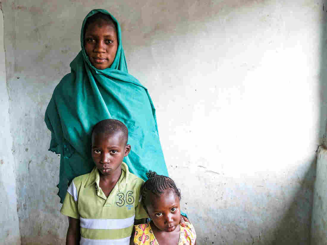 Aissatou Sanogo with two of her three children, Issa, 7, and Binetou, 3. Her 2-year-old was asleep when the picture was taken. Their father drowned in the Mediterranean while trying to reach Europe, hoping to earn a good living there to support his family in Senegal.