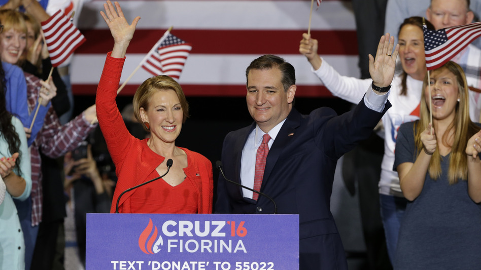 Republican presidential candidate Sen. Ted Cruz is joined by former Hewlett-Packard CEO Carly Fiorina during a rally in Indianapolis on Wednesday. Cruz announced he has tapped Fiorina to serve as his running mate. (Michael Conroy/AP)