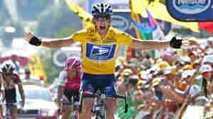 Lance Armstrong reacts as he crosses the finish line to win the 17th stage of the Tour de France in 2004.