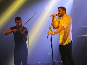 Hamed Sinno (R) and Haig Papazian of the Lebanese alternative rock band Mashrou' Leila performing in Bourges, France in 2015.