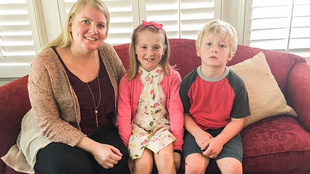 Tracy Smith, 38, and her children Hazel, 8 and Finley, 5 at their home in Houston. Smith is pregnant with twins and says she's a little more worried than usual about the approach of mosquito season. (Houston Public Media)