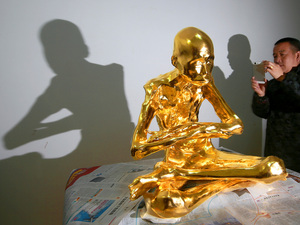 A man photographs the mummified body of revered Buddhist monk Fu Hou in March in Quanzhou city in southeastern China's Fujian province.