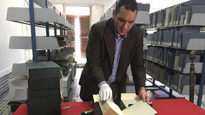 The curator of the Qarawiyyin Library, Abdelfattah Bougchouf, opens an original version of a famous work, Muqaddimah, written by historian Ibn Khaldun in the 14th century. The library in Fez is one of the world's oldest working libraries, dating to the 10th century when it was founded by a pioneering woman. The library is set to reopen in May following a renovation.